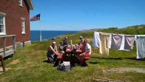 Two families enjoying a picnic beneath our clothesline